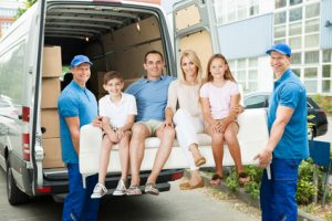 Hire Movers Carrying Family on Sofa